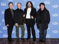 Kansas vocalist and violinist Robby Steinhardt, second from the right, has died aged 71 (Richard Shotwell/Invision/AP, File)