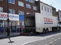 A delivery lorry outside a Tesco Express store in central London (Yui Mok/PA)