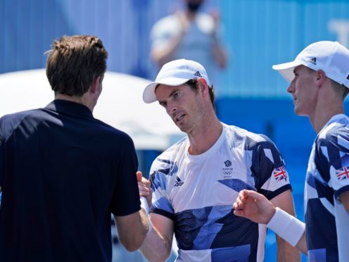 Andy Murray (second right) and Joe Salisbury bump fists with Nicolas Mahut and Pierre-Hugues Herbert (Seth Wenig/AP)