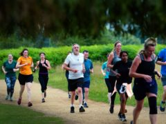 Runners taking part in the Parkrun at Bushy Park in London, the largest and oldest Parkrun in the UK, and one of many runs taking place across the country for the first time since last March. Picture date: Saturday July 24, 2021.