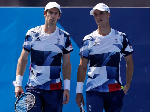 Andy Murray, left, with focus on playing doubles with Joe Salisbury (Seth Wenig/AP)