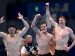 James Guy, Matthew Richards and Tom Dean celebrate gold (Adam Davy/PA)
