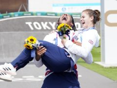 Great Britain's Beth Shriever and Kye Whyte celebrate their gold and silver BMX medals (Danny Lawson/PA)