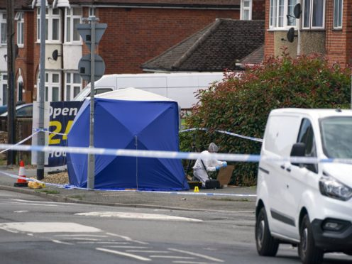 Police activity at the scene in Micklefield Road, High Wycombe (Steve PArsons/PA Wire)