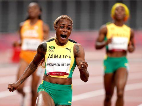 Jamaica's Elaine Thompson-Herah celebrates winning the 100m. (Mike Egerton/PA)