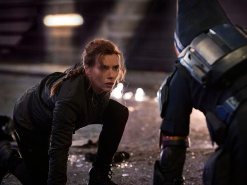 This image released by Marvel Studios shows Scarlett Johansson in a scene from Black Widow. (Jay Maidment/Marvel Studios-Disney via AP)