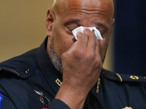 US Capitol Police Sgt Harry Dunn wipes his eyes during the House select committee hearing (Andrew Harnik, Pool/AP)