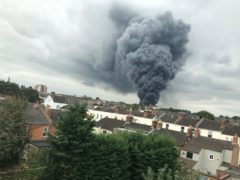 Huge plumes of smoke can be seen rising from the scene (West Midlands Ambulance Service/PA)