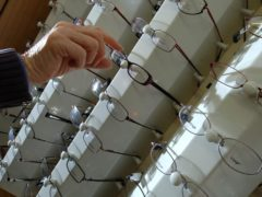 Choosing frames for glasses during a visit to the opticians (PA)