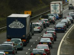 The crash caused lengthy queues on the M74 as an investigation was carried out (David Cheskin/PA)