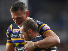 Kevin Sinfield (left) and Rob Burrow embrace after the match at Headingley (Dave Howarth/PA).