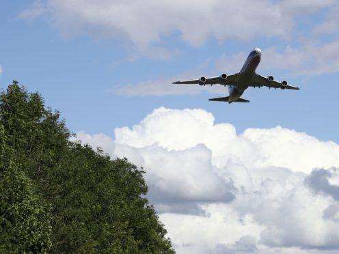 A plane takes off (Tim Goode/PA)