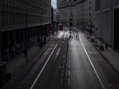 A lone man crosses an empty street in Westminster, central London (Victoria Jones/PA)