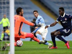 Ferran Torres, centre, finds the net for Manchester City (Martin Rickett/PA)