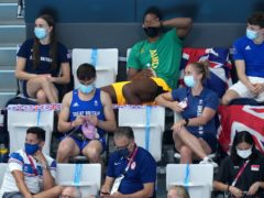 Tom Daley knits in the stands (Joe Giddens/PA)
