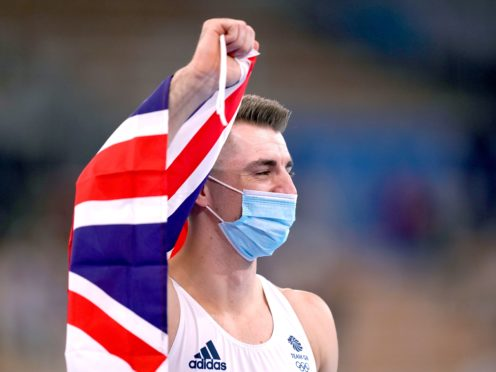 Great Britain's Max Whitlock celebrates after winning the gold medal in the men's pommel horse (Mike Egerton/PA)