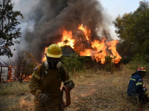 Firefighters operate during a wildfire near Lampiri village (Andreas Alexopoulos/AP)