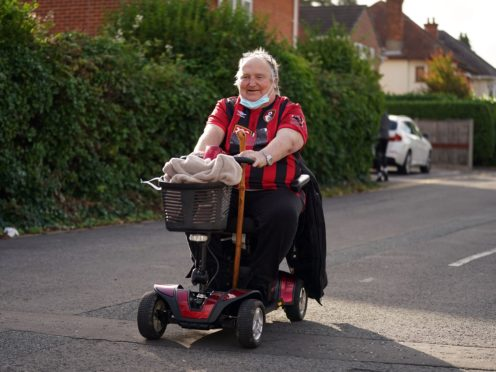 A Bournemouth fan arrives for his team's Championship match against West Brom on Friday (John Walton/PA)