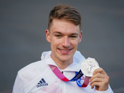 Cyclist Ethan Hayter holds his Olympic silver medal at a homecoming party at Herne Hill Velodrome in south London (Kirsty O'Connor/PA)