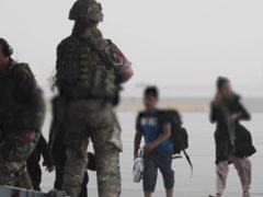 Afghan civilians walking on to an RAF aircraft at Kabul (MoD/PA)