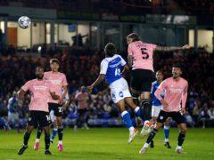 Cardiff City's Aden Flint (second right) scores (Joe Giddens/PA)