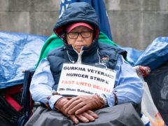 Gurkha veteran Dhan Gurung returned to the protest after being treated in hospital (Stefan Rousseau/PA)