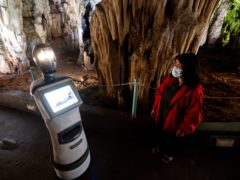 A guide programs Persephone inside Alistrati Cave, north-east of Thessaloniki, Greece (Giannis Papanikos/AP)
