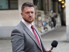 Tommy Robinson outside Westminster Magistrates' Court, where he is accused of stalking Independent home affairs correspondent Lizzie Dearden, who has applied for a stalking protection order against him (Stefan Rousseau/PA)
