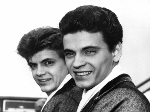 Phil, left, and Don of the Everly Brothers arrive at London Airport in 1960 (AP)
