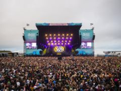 Festivalgoers watching Dizzee Rascal during the Boardmasters music and surfing festival in Cornwall (Andrew Timms/Boardmasters/PA)