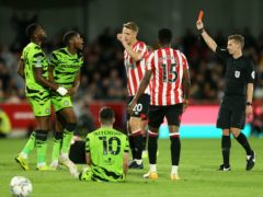 Forest Green Rovers' Ebou Adams (second left) receives a red card from referee Will Finnie during the Carabao Cup second round match at Brentford Community Stadium (Steven Paston/PA)