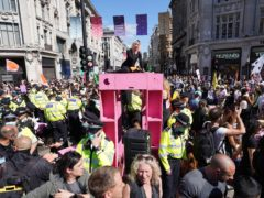 Demonstrators during a protest by Extinction Rebellion at Oxford Circus (Stefan Rousseau/PA)