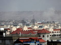 Smoke rises from a deadly explosion outside the airport in Kabul (Wali Sabawoon/AP)