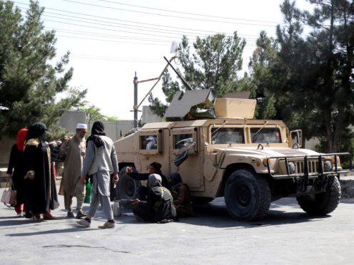 Taliban fighters guard outside the airport in Kabul, Afghanistan (AP)