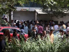 Afghans wait for hours to try to withdraw money, in front of Kabul Bank (AP)