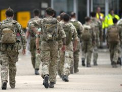Member of the British armed forces 16 Air Assault Brigade walk to the terminal after disembarking a RAF Voyager aircraft at RAF Brize Norton, Oxfordshire (Alastair Grant/PA)