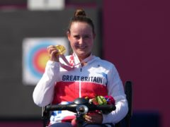 Great Britain's Phoebe Paterson Pine poses on the podium with her archery gold medal (Tim Goode/PA)