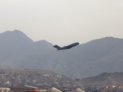 A US military aircraft takes off from the Hamid Karzai International Airport in Kabul (Wali Sabawoon/AP)