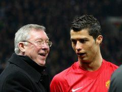Sir Alex Ferguson, left, spoke to Cristiano Ronaldo about a return to Old Trafford (Martin Rickett/PA)