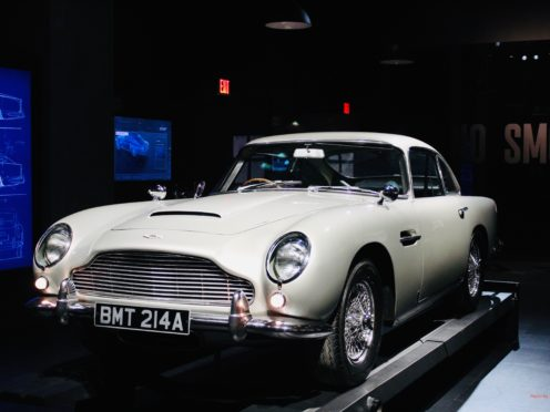 A new podcast series will investigate the disappearance of an Aston Martin DB5 driven by Sir Sean Connery in Goldfinger (Spyscape Podcast Network/PA)