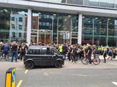 Crowds of protesters outside ITN's headquarters in Camden (Nico Hogg/PA)