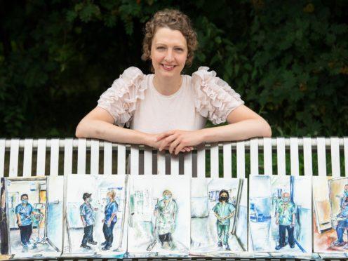 Artist Gillian McLaren with her portraits (Lesley Martin/PA)