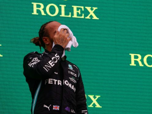 Lewis Hamilton says he has been suffering with symptoms of long Covid (Florion Goga/Pool via AP)