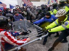 The riot at the Capitol in Washington (John Minchillo/AP)