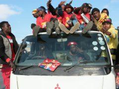 Supporters of Zambian opposition leader Hakainde Hichilema celebrate on the streets of Lusaka, Zambia (Tsvangirayi Mukwazhi/AP)
