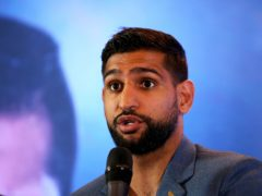 The 34-year-old boxer alleged he had been 'banned' by American Airlines (Steven Paston/PA)