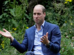 The Duke of Cambridge speaks with service users during a visit to the Garden House part of the Peterborough Light Project, a charity which offers advice and support to rough sleepers (Kirsty Wigglesworth/PA)