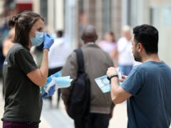 Health Secretary Sajid Javid said a surge in Covid-19 cases this winter could see people in England ordered to wear face masks and show passes to prove their vaccination status (Andrew Matthews/PA)