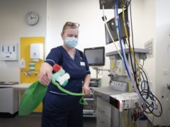 Charge nurse Katy Currie sets up equipment in the Resuscitation Room in the Emergency Department at the Royal Hospital for Children and Young People Edinburgh (Jane Barlow/PA)