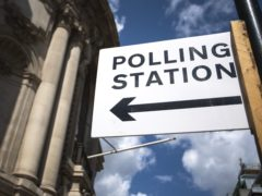 Signage outside a polling station in central Westminster (PA)